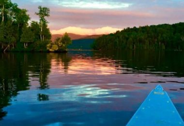 Canoeing in Lake Chateaugay, NY at Camp Jeanne d'Arc for Girls