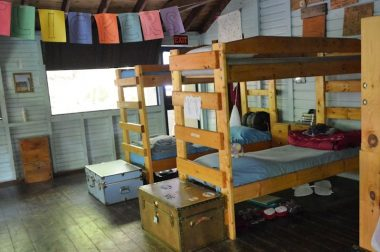 Bunkbeds in the Flicker Cabin, with trunks placed at the feet of each one