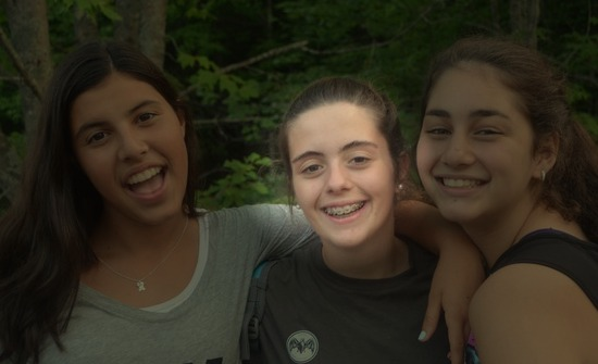 Graciela U., a camper from Spain, grouped with a couple other young girls