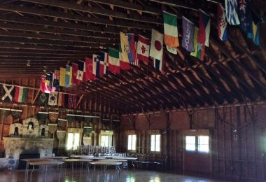 Interior of the Hearth (Dining), featuring flags hung from the rafters
