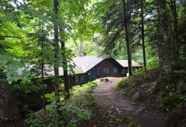 Narrow trail leading to Little Building (Arts and Crafts/Music) at a camp for kids