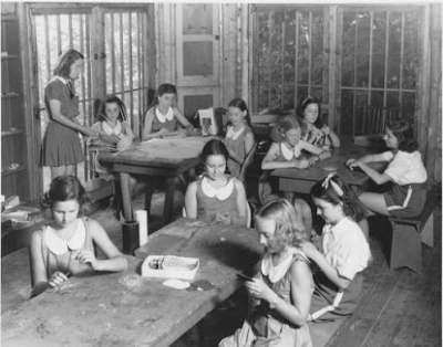 Historic photo of campers participating in the arts as one of the summer camp programs offered at Camp Jeanne d'Arc