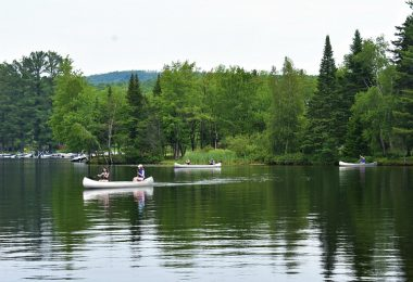 Outdoor summer camp, allowing girls to canoe at camp as an activity