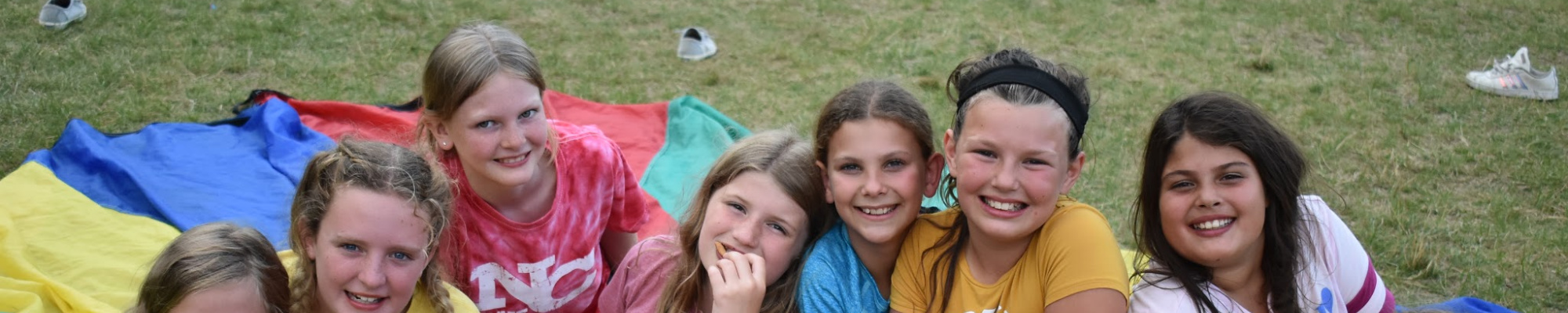Young girls lined up, camping together and building friendships