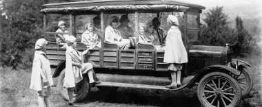 Black and White version of young girls getting into a 1920 car