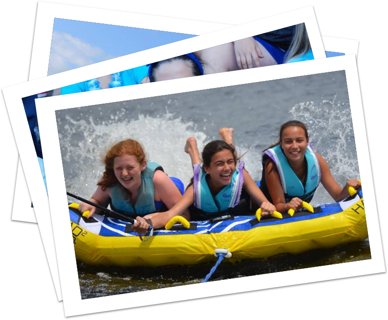 Three girls participating in water sports on Lake Chateaugay at a sleep away summer camp in NY