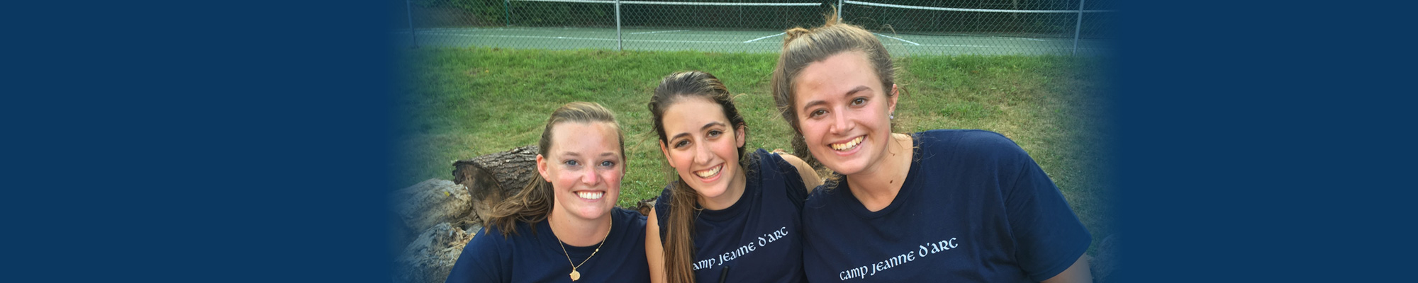 Three girls smiling, while attending a leadership camp for high school students in the Adirondack Mountains