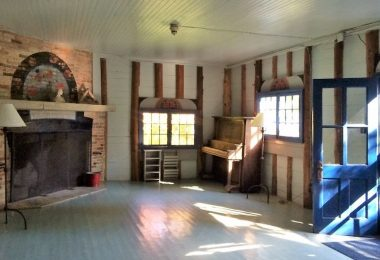 Interior view of Woodsheart building, the living room, which is a gathering place for campers at Camp Jeanne d'Arc